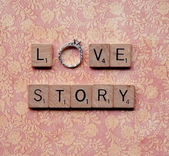 the word love in scrabble letters and the word story underneath