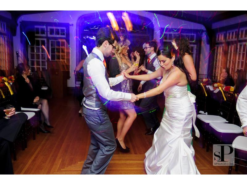 a bride and groom dancing to fast paced music