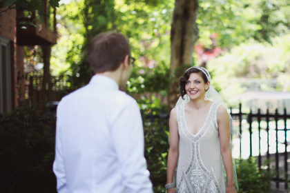 A bride and groom seeing each other for the first time, before the wedding